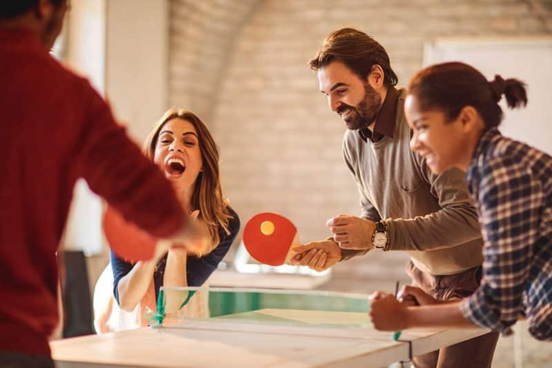 employees playing ping pong